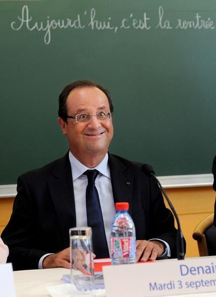 547040-french-president-francois-hollande-smiles-as-he-chairs-a-round-table-discussion-on-the-changes-in-th